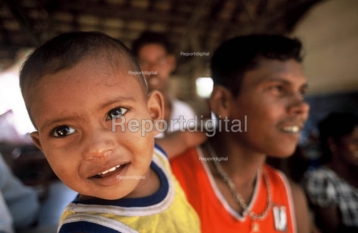 A child displaced by the Tsunami living in a displaced peoples camp set up in a school in Akkaraipattu, Sri Lanka. 2005 - Howard Davies - 2005-03-05