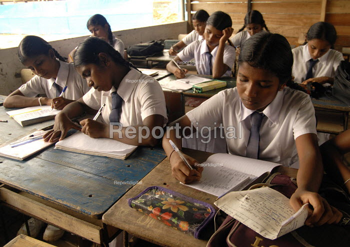School children in a temporary classroom while their school is being built - with funding from Oxfam - having been destroyed during the Tsunami. Sri Lanka 2006 - Howard Davies - 2006-09-08