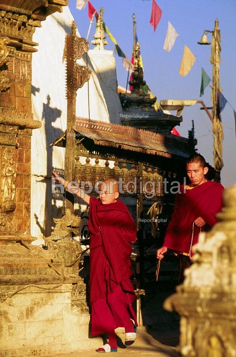 Buddhist monks with prayer wheels. At the Swayambhunath stupa, in Kathmandu. - Howard Davies - 1997-08-03