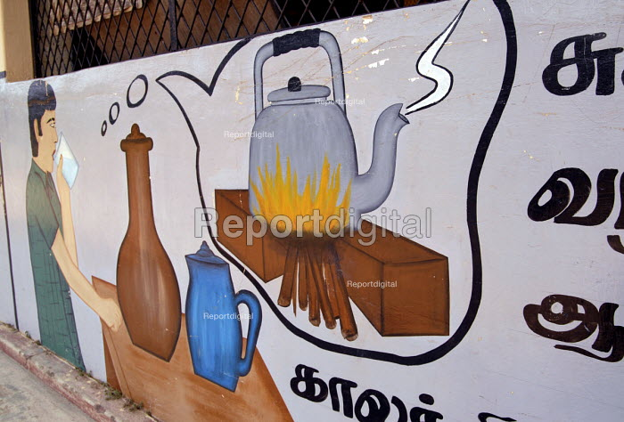 Public health awareness murals painted by Oxfam on the walls of a school in Ampara district. The message reads : Always boil water and cool before drinking. Sri Lanka 2007 - Howard Davies - 2007-10-19