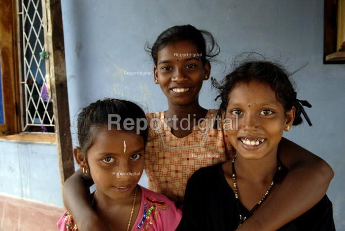 Three children outside a house rebuilt after the Tsunami on the south coast of Sri Lanka 2007 - Howard Davies - 2007-10-19