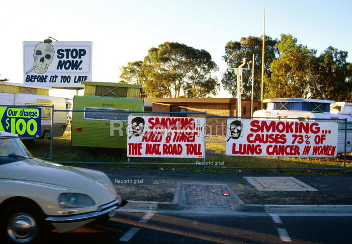 Protest banners and signs against cigarette smoking. Warning that smoking causes lung cancer. - Howard Davies - 1985-05-03