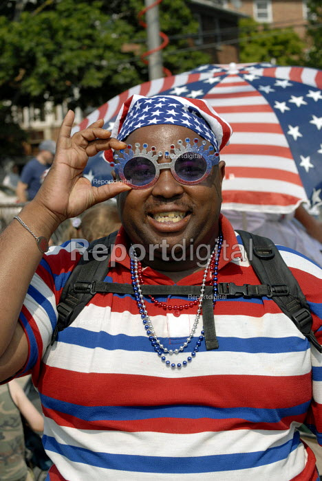 Afro-American in colours of American flag, Memorial Day Parade, Douglaston to commemorate US service people who have died in military service. USA 2006 - Howard Davies - 2006-05-29