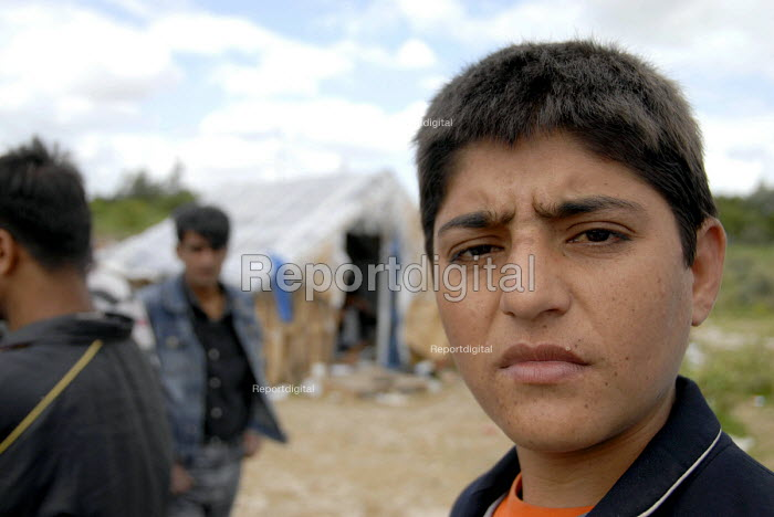 A young Afghan asylum seeker camped in makeshift huts in sand dunes near Dunkerque on the north coast of France. 2009 - Howard Davies - 2009-07-15
