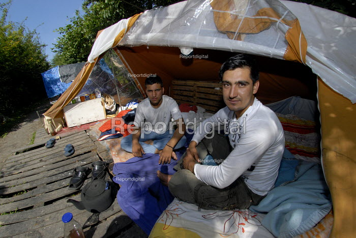 Afghan asylum seekers camped in woods near Dunkerque on the north coast of France. 2009 - Howard Davies - 2009-07-16