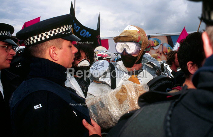 WOMBLE activist at a protest against an arms trade fair London, UK 2001 - Howard Davies - 2001-08-01