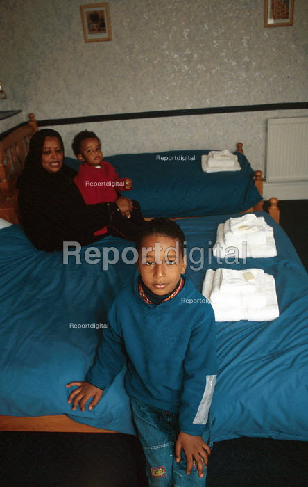 An asylum seeker family who have been dispersed at temporary accommodation run by Cardiff City Council, Wales, UK. 2002 - Howard Davies - 2002-08-01