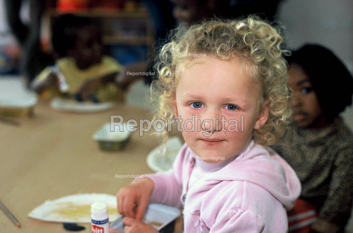 Children whose family are seeking asylum in Ireland at a playgroup at a Direct Provision Centre established by the Irish Government to house and care for refugees until their cases have been decided upon. Co Meath, Ireland 2004 - Howard Davies - 2004-05-05
