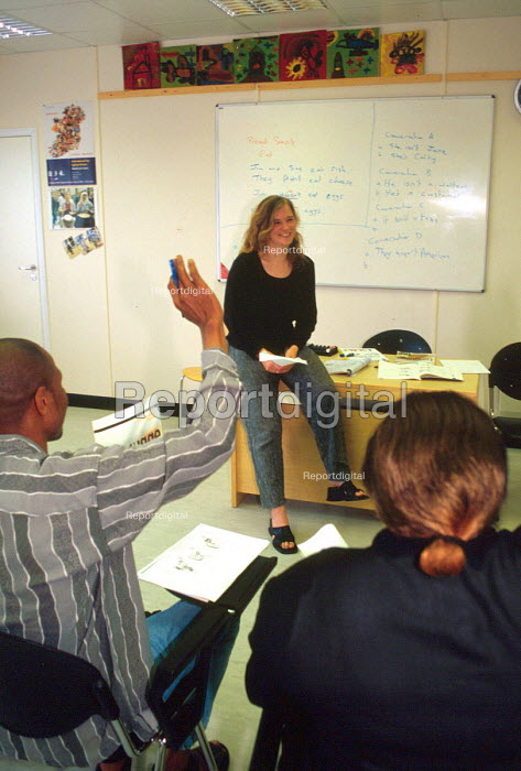 English class for asylum seekers at a Direct Provision Centre, Knockalisheen , Co Clare, Ireland - Howard Davies - 2002-08-01