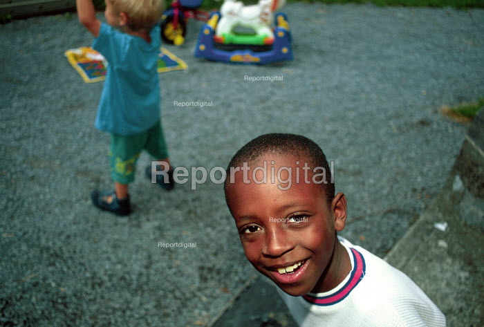 Child whose families are seeking asylum in Ireland at a playgroup in Ennis, Ireland. 2002 - Howard Davies - 2002-08-01