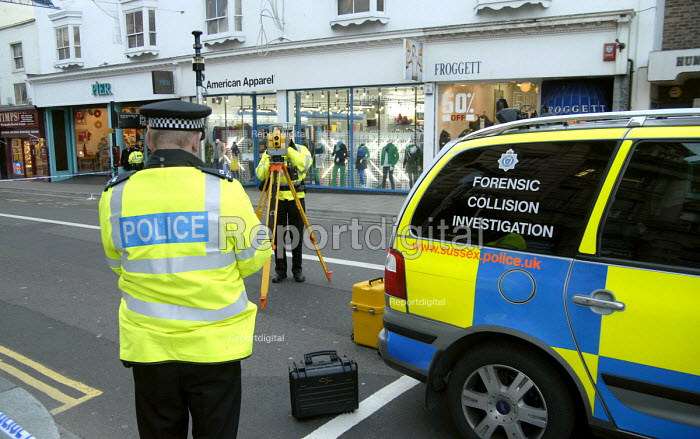 Police officers from a Forensic Collision Investigation Unit attending the aftermath of a serious road traffic incident. Brighton, UK - Howard Davies - 2007-11-24
