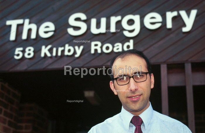 GP who is a refugee from Afghanistan, and who also has campaigned for better recognition of refugee doctor qualifications, outside his practice surgery . UK 1998 - Howard Davies - 1998-08-01