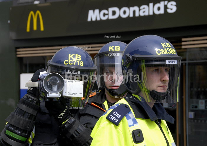 Police FIT Forward Intelligence Team film demonstrators attacking a McDonalds during May Day protest against EDO a Brighton based arms manufacturer, Brighton, UK 2009 - Howard Davies - 2009-05-04