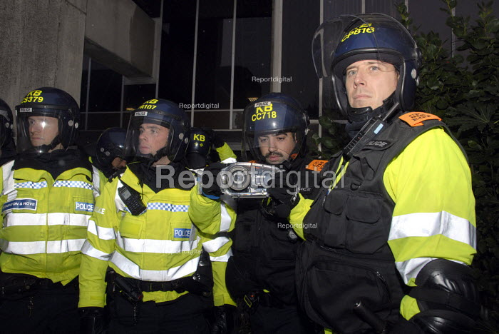 Police FIT team photograph students as they protest against education cuts and university tuition fees , Brighton, UK 2010 - Howard Davies - 2010-11-30