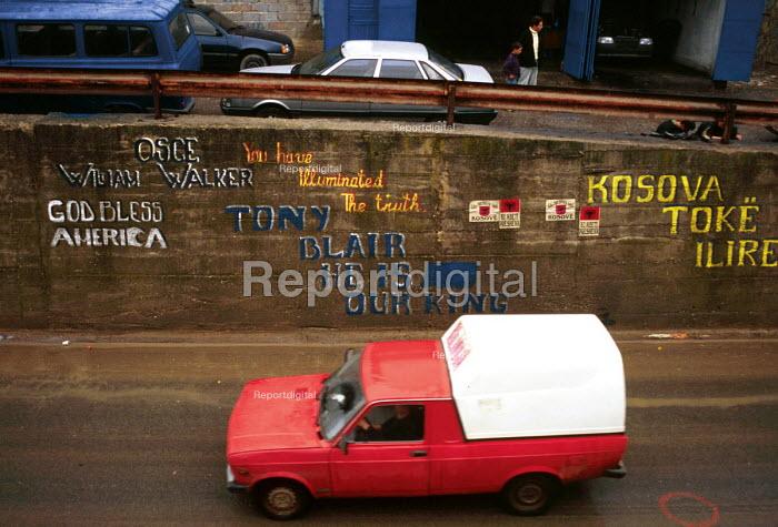Pro NATO graffiti in post war Kosovo. Kosovo. 1999 - Howard Davies - 1999-05-01