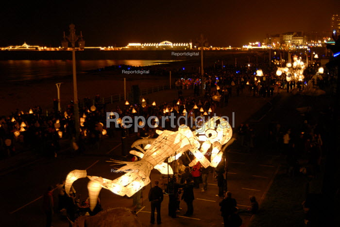 'Burning of the Clocks' Parade, held annually in Brighton, a winter solstice festival. At which massive lanterns and models are burnt on a large bonfire, at the end of the Parade. - Howard Davies - 2006-12-21