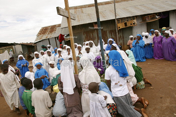 The Legion Maria church, an offshoot of the Catholic Church, hold a service in Mathare slum in Nairob, The church is active in Kenyas slums which have given birth to hundreds of indegenous churches. Nairobi, Kenya 2003 - R. Chalasani - 2003-05-11