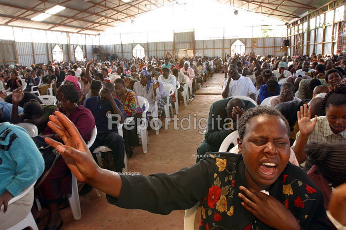 Kenyans with HIV / AIDS and their families at a service at Gods Power Church where they believe they might be cured. In a country where health care is minimal and most cant afford treatment for AIDS many have turned to religion to cope with illness. Nairobi, Kenya 2003 - R. Chalasani - 2003-05-11