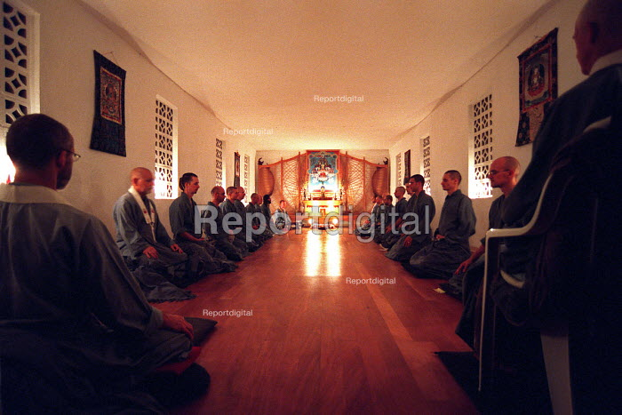 Members of the Western Buddhist Order meditating in the shrine room at the Guhyaloka Retreat Centre in Spain - Timm Sonnenschein - 2004-10-20