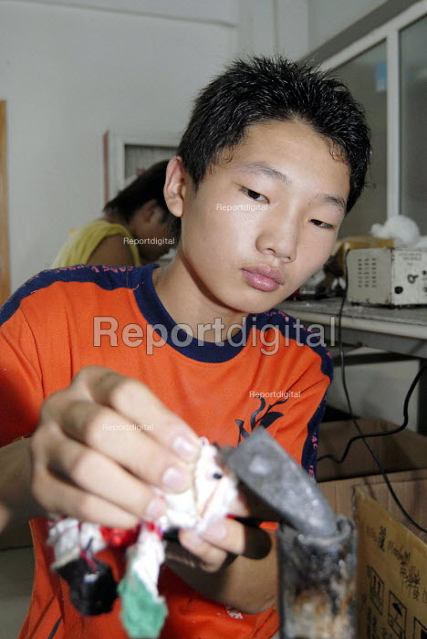 Young boy working in the Toy Home soft toy factory, Shanghai, China - Timm Sonnenschein - 2006-09-01