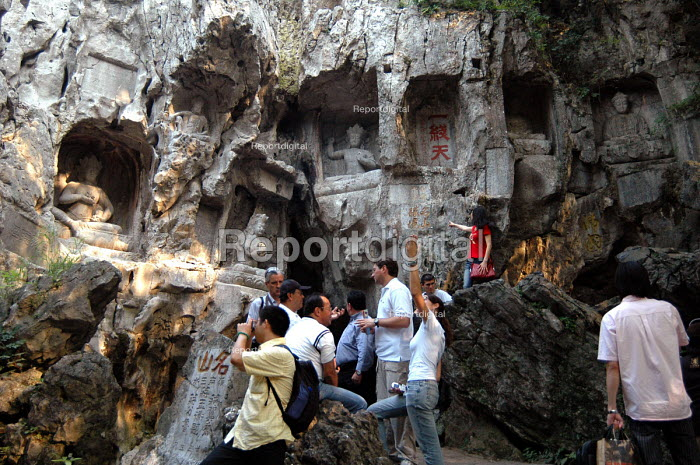 Western & Chinese tourists viewing stone carvings, Ling Yin Temple, Hang Zhou, China - Timm Sonnenschein - 2005-09-14