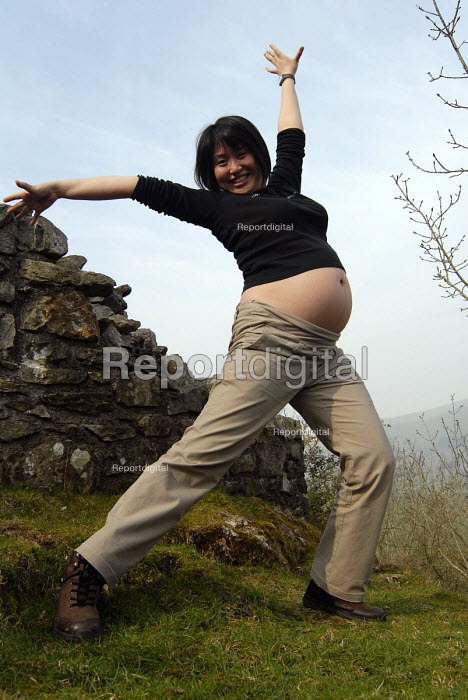 7 month pregnant woman doing �exercises �in the Welsh hills - Timm Sonnenschein - 2007-04-14