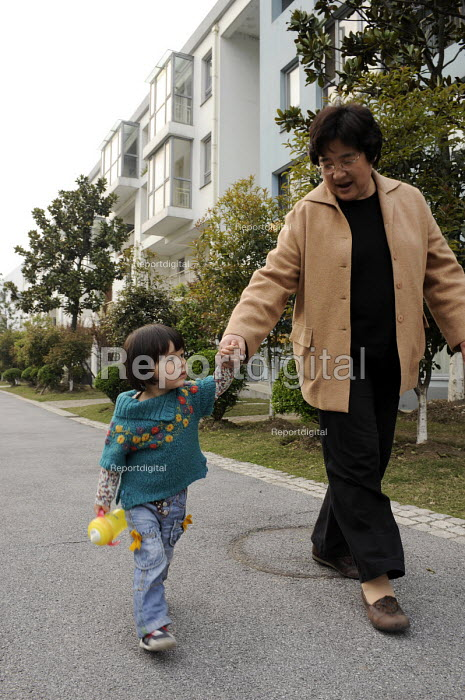 A grandmother is walking with her grandaughter, Anting, Shanghai, China - Timm Sonnenschein - 2009-04-07