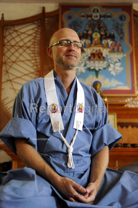 A member of the Western Buddhist Order is meditating in the shrine room at Guhyaloka Retreat Centre, Spain - Timm Sonnenschein - 2009-08-22