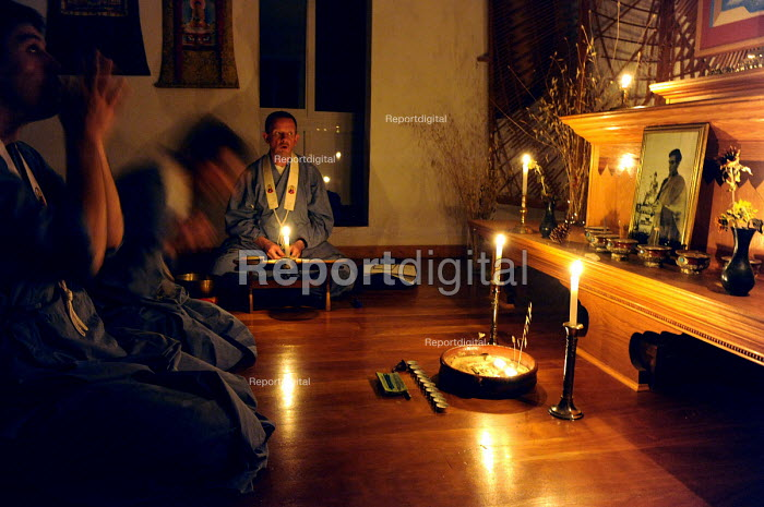 Members of the Western Buddhist Order are doing Puja in the candle lit shrine room at Guhyaloka Retreat Centre, Spain - Timm Sonnenschein - 2009-08-22