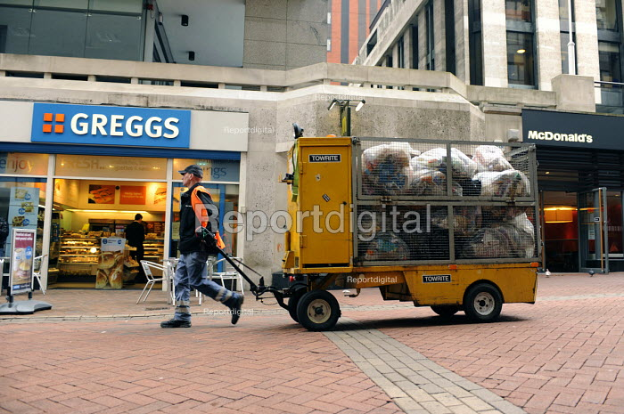 A council worker pulling a trolley and collecting bin bags, Birmingham City Centre - Timm Sonnenschein - 2010-03-24