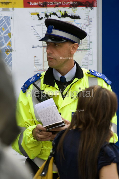 A Police Community Support Office taking notes at Tottenham Court Road in Central London - Timm Sonnenschein - 2010-06-09