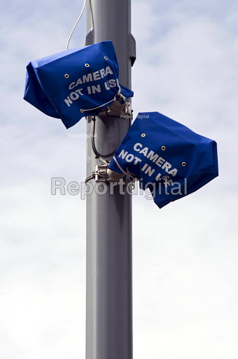 Bagged up ANPR surveillance �cameras installed to monitor vehicles entering and leaving Birmingham areas with a high �Muslim population. The anti terrorist scheme is under criticism and they are currently switched of whilst a public investigation takes place. - Timm Sonnenschein - 2010-07-08