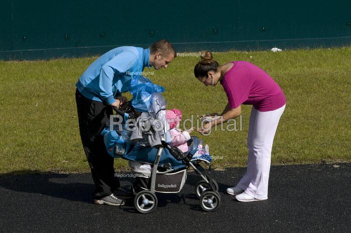 Parents feeding cheap fast food to their infant daughter, Bradford - Timm Sonnenschein - 2010-08-28