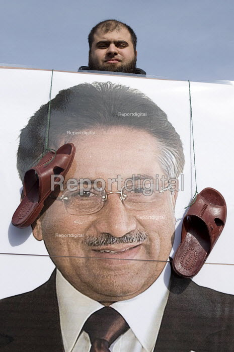 A protester holding a portrait of Pervez Musharraf with sandals in his face, as he is giving his first public speech the day after forming a new political party, Handsworth, Birmingham - Timm Sonnenschein - 2010-10-02