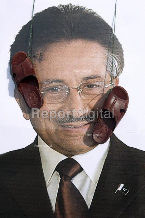 A �portrait of Pervez Musharraf with sandals in his face, as he is giving his first public speech the day after forming a new political party, Handsworth, Birmingham - Timm Sonnenschein - 2010-10-02