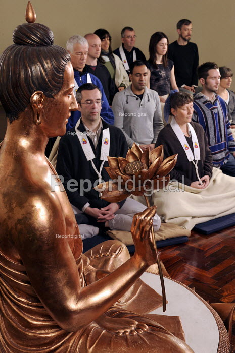 Members of the Triratna Buddhist Order meditating in the shrine room of the Birmingham Buddhist Centre infront of a western Buddha figure - Timm Sonnenschein - 2009-10-11