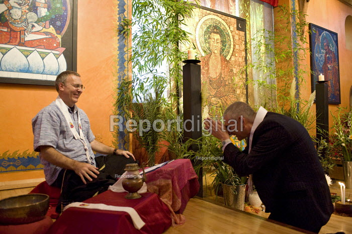Dharmachari Padmavajra publicly ordaining Roy Peters into the Triratna Buddhist Order giving him a Buddhist kesa in a ceremony where he also received �the Buddhist name Mahasiddhi, Padmaloka Retreat Centre, Surlingham, Norfolk - Roy Peters - 2010-09-23