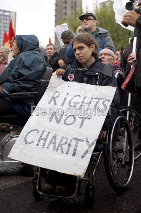 A disabled women in a wheelchair holding a placard saying Rights not Charity during the Right to Work March against government cuts on the opening day of the Conservative Party conference in Birmingham - Timm Sonnenschein - 2010-10-03