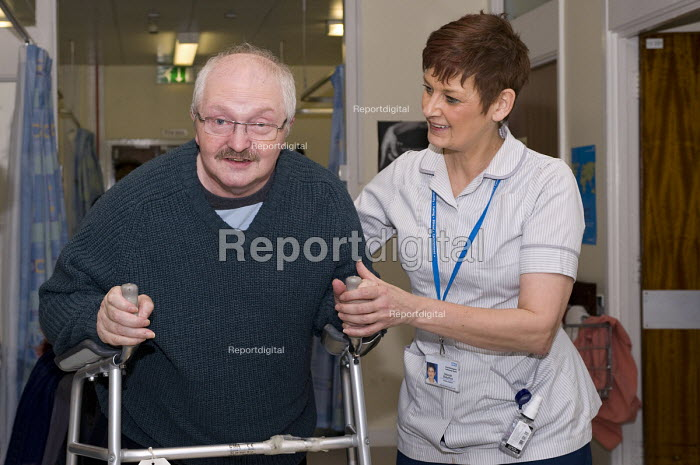 An NHS rehab assistant helping a patient recovering mobility, Moseley Hospital, Birmingham - Timm Sonnenschein - 2010-11-18