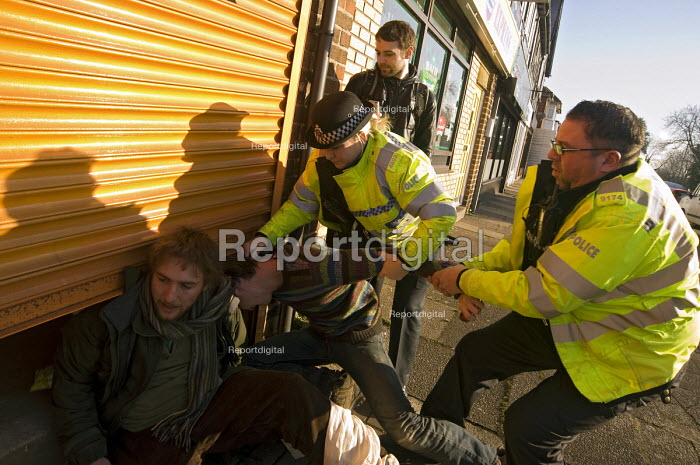 Police officers trying to remove students during their occupation of John Hemming Liberal Democrats MPs office on during a protest against University fees urging him to vote against the introduction of them, Birmingham - Timm Sonnenschein - 2010-12-06