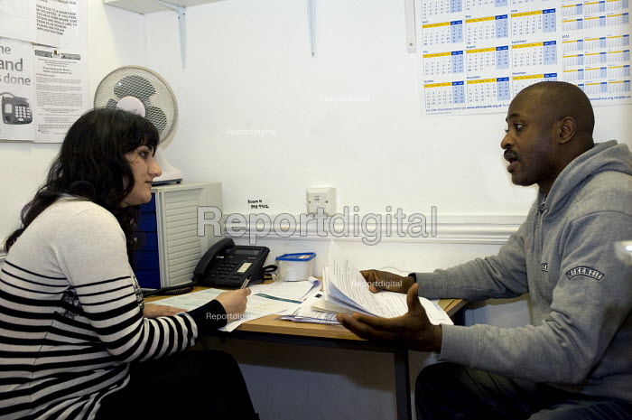 A volunteer worker helping a man seeking advise at the Handsworth Citizens Advice Bureau, which is facing closure due the Birmingham City Council withdrawing 600,000 funding for all five walk in advice centres in the city - Timm Sonnenschein - 2011-02-04