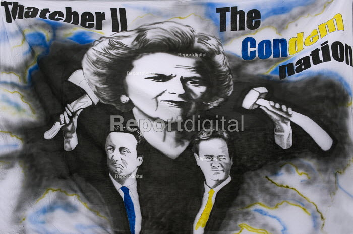 A banner depicting Margaret Thatcher, David Cameron and Nick Clegg �during the TUC March For the Alternative, London - Timm Sonnenschein - 2011-03-26
