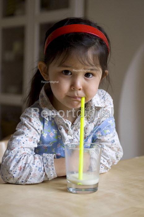 A girl drinking a glass of soya milk. - Timm Sonnenschein - 2011-05-04
