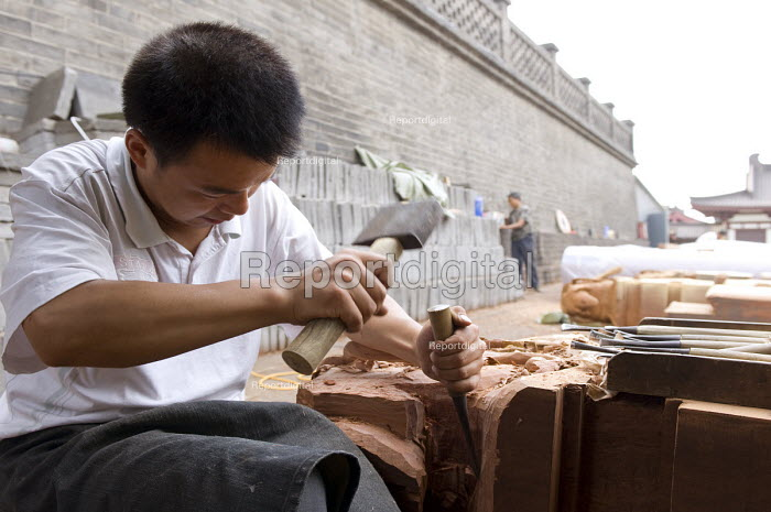Traditional craftsmen preparing the woodwork for a new temple hall next to the Buddhist Wild Goose Pagoda. China - Timm Sonnenschein - 2011-08-02