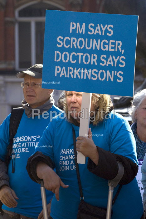 PM says scrounger doctor says Parkinsons Disease. The Hardest Hit rally, disabled people protest against government cuts, Victoria Square, Birmingham - Timm Sonnenschein - 2011-10-22