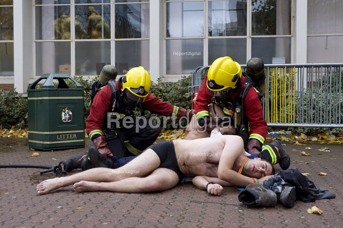 Firefighters and a volunteer during Birmingham Shield exercise simulating chemical, biological, radiological or nuclear (CBRN) incident - Timm Sonnenschein - 2011-10-30