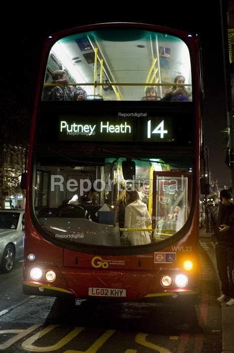 Bus driver with boarding passengers at Brompton Road, London. - Timm Sonnenschein - 2011-11-20