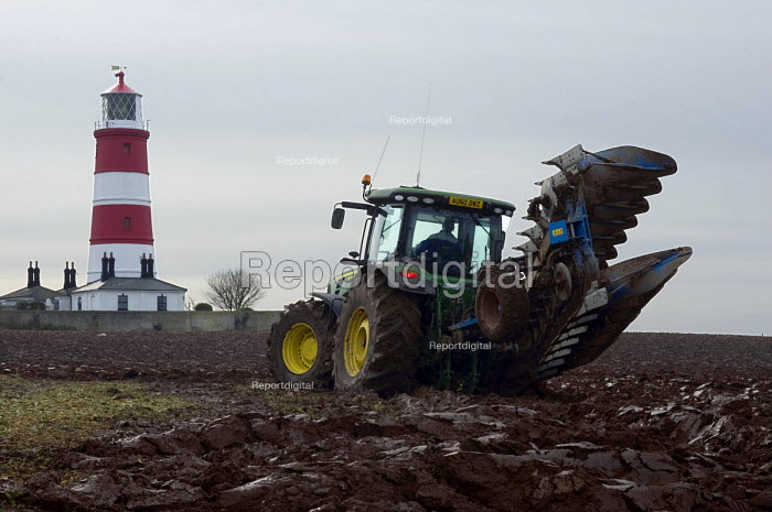 A Farmer ploughing a field and Happisburgh Lighthouse, Norfolk, East Anglia - Timm Sonnenschein - 2012-02-16