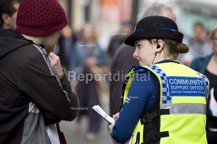A female �British Transport Police �PCSO questioning witnesses about an incident on New Street, Birmingham - Timm Sonnenschein - 2012-03-22