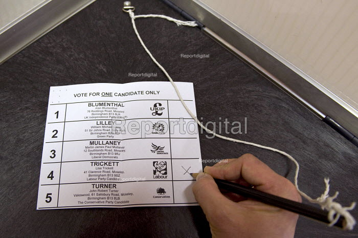 Marking the ballot paper with a cross in a voting booth at a polling station. Voting Lisa Trickett the Labour Party candidate as councillor for Kings Heath during the Birmingham City Council Election. - Timm Sonnenschein - 2012-05-03